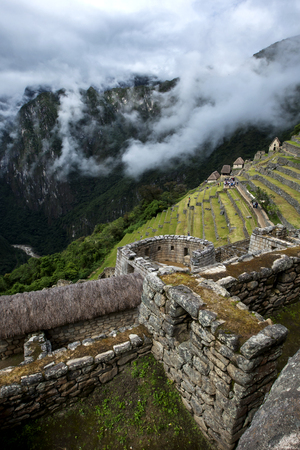 metres: The incredible ancient ruins of Machu Picchu in Peru showing the Torreon. Machu Picchu is a 15th-century Inca site located 2,430 metres (7,970 ft) above sea level and is situated on a mountain ridge above the Sacred Valley which is 80 kilometres northwest