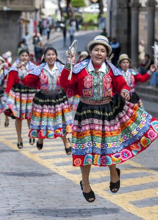 colourfully: Colourfully dressed Peruvian ladies dance at the Plaza de Armas in Cusco in Peru during May Day celebrations.