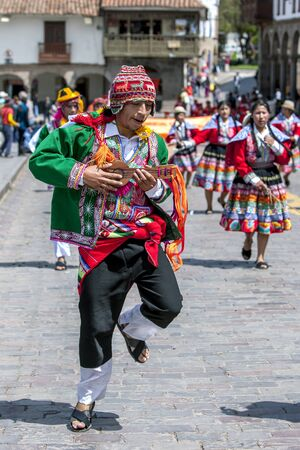 plaza de armas: A dancing musician dressed in Peruvian costume performs at Plaza de Armas during the May Day parade in Cusco, Peru. Editorial