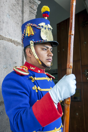 ecuadorian: A Ecuadorian guard stands on duty at the entrance to Carondelet Palace in Quito in Ecuador in South America. Carondelet Palace is the seat of Ecuadorian government and is opposite Independence Square.