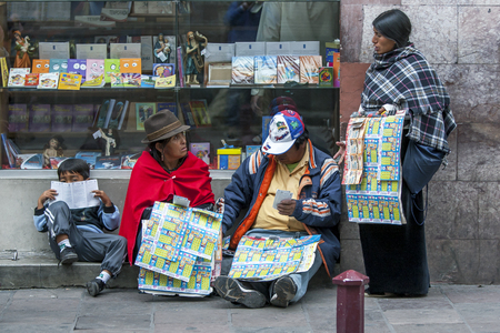ecuadorian: Vendors selling lottery tickets near Independence Square in Quito in Ecuador in South America. Quito is the seat of Ecuadorian government.