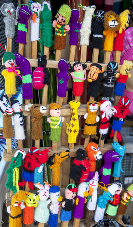 puppets: A variety of finger puppets for sale at the market in Peguche in Ecuador. Stock Photo