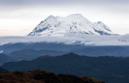 metres: The Antisana volcano as seen from the hot springs of Papallacta in Ecuador. It is the fourth highest volcano in Ecuador, at 5,704 metres (18,714 ft), and is located 50 kilometres (31 mi) SE of the capital city of Quito.
