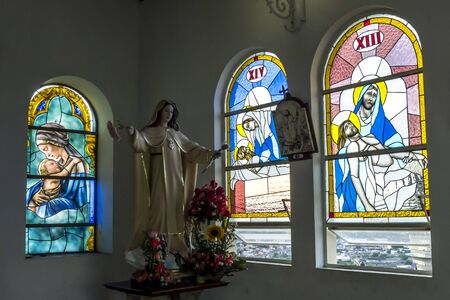 stained glass windows: The beautiful interior of the chapel displaying stained glass windows at the summit of Santa Ana Hill in Guayaquil in Ecuador. To reach the hilltop you need to climb 444 steps from the Las Penas neighbourhood below. Editorial