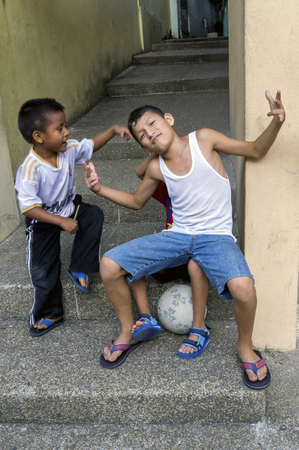 neighbourhood: Boys sitting on steps on Santa Ana Hill in the Guayaquil neighbourhood of Las Penas. The climb to the summit of Santa Ana Hill requires 444 steps to be negotiated.