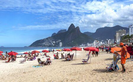 A sea of umbrellas line Ipanema Beach at Rio de Janeiro in Brazil.