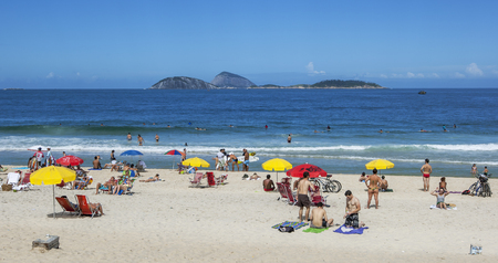rio: People relax on Ipanema Beach at Rio de Janeiro in Brazil.