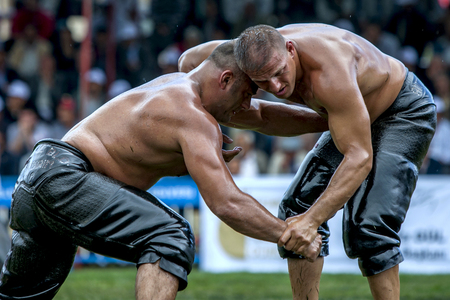 heavy weight: Heavy weight wrestlers compete at the Kemer Turkish Oil Wrestling Festival, Kemer, Turkey. Editorial