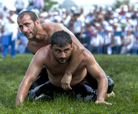 wrestlers: Wrestlers battle to avoid being eliminated from competition at the Izmit Turkish Oil Wrestling Festival in Turkey.