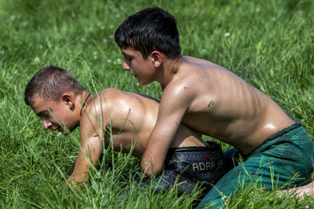 opponent: A young wrestler overpowers his opponent at the Kirkpinar Turkish Oil Wrestling Festival in Edirne in Turkey. Editorial