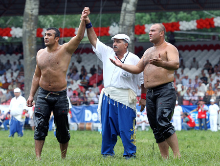 heavy weight: A heavy weight wrestler is awarded victory at the Kirkpinar Turkish Oil Wrestling Festival in Edirne in Turkey.