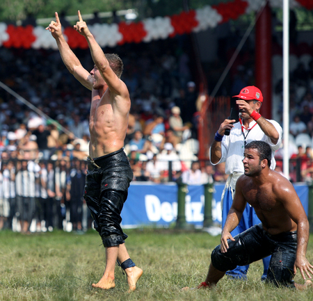 edirne: A middle weight wrestler celebrates victory on the final day of competition at the Kirkpinar Turkish Oil Wrestling Festival in Edirne in Turkey.