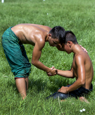 edirne: A young wrestler consoles his opponent after victory at the Kirkpinar Turkish Oil Wrestling Festival in Edirne, Turkey.