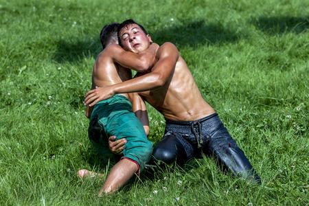 edirne: Young wrestlers battle for victory at the Kirkpinar Turkish Oil Wrestling Festival in Edirne, Turkey. Editorial