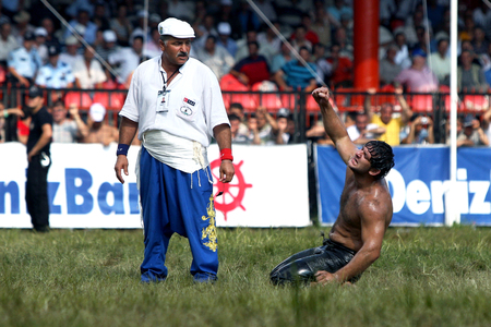 edirne: An exhausted middle weight wrestler celebrates victory on the final day of competition at the Kirkpinar Turkish Oil Wrestling Festival in Edirne in Turkey.