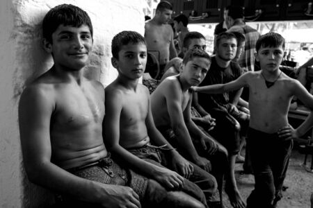 edirne: Young wrestlers wait to compete at the Kirkpinar Turkish Oil Wrestling Festival In Edirne, Turkey. Editorial
