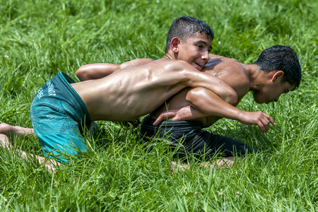 wrestlers: Young wrestlers battle for victory at the Kirkpinar Turkish Oil Wrestling Festival in Edirne, Turkey. Editorial