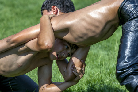 wrestlers: Young wrestlers battle for victory at the Elmali Turkish Oil Wrestling Festival in Elmali, Turkey.