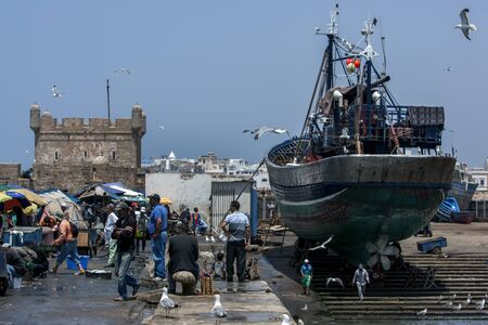 18th: A fishing trawler sits in dry dock at the busy fishing port of Essaouira in Morocco. The present city of Essaouira was built during the 18th century by Mohammed III who wished to reorient his kingdom toward the Atlantic for security reasons. French engine