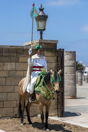 mounted: A mounted soldier at the 12th Century walled entrance to Hassan Tower in Rabat, Morocco.