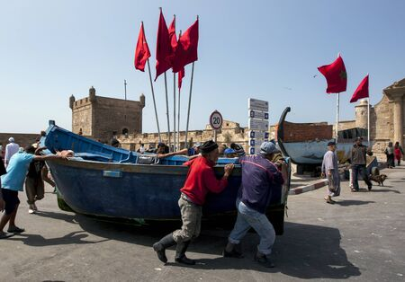 18th: Fisherman move a boat in the port of Essaouira, Morocco. The present city of Essaouira was built during the 18th century by Mohammed III who wished to reorient his kingdom toward the Atlantic for security reasons. French engineer, Theodore Cornut built th Editorial