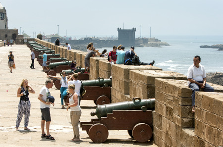 18th century: Visitors inspect a row of canons at the former fortress at Essaouira in Morocco. The present city of Essaouira was built during the 18th century by Mohammed III who wished to reorient his kingdom toward the Atlantic for security reasons. French engineer,
