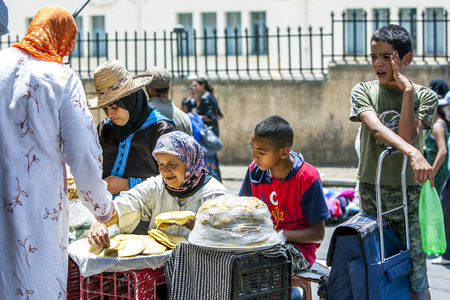 medina: A trader selling bread outside the Meknes Medina, Morocco. Editorial