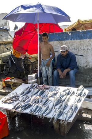 18th: A man and boy selling a variety of fish at the fishing port of Essaouira in Morocco. The present city of Essaouira was built during the 18th century by Mohammed III who wished to reorient his kingdom toward the Atlantic for security reasons. French engine