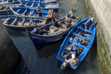 18th century: Fishing boats enter a section of the harbour at the busy fishing port of Essaouira in Morocco. The present city of Essaouira was built during the 18th century by Mohammed III who wished to reorient his kingdom toward the Atlantic for security reasons.