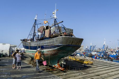 18th: A fishing trawler sits in dry dock at the busy fishing port of Essaouira in Morocco. The present city of Essaouira was built during the 18th century by Mohammed III who wished to reorient his kingdom toward the Atlantic for security reasons.