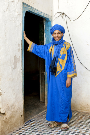 ali: A portrait of Ali the Berber wearing a traditional robe at Ksar Ouled Abd El Halim in Rissani in Morocco. Editorial