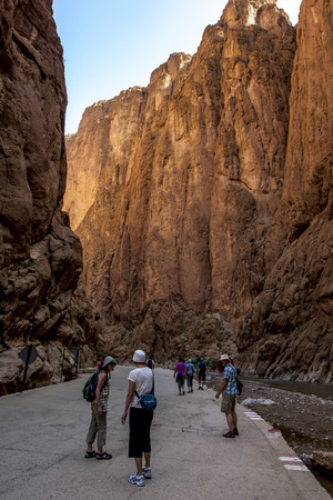 metres: Tourists begin their walk through the Todra Gorge at Tinerhir in Morocco. The canyon, formed by thousands of years of river erosion, narrows to a flat stony track, in places as little as 10 metres (33 ft) wide, with a sheer rock face up to 160 metres (525 Editorial