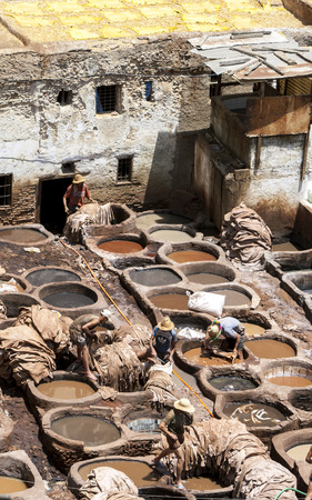 11th: Men working at the famous Chouara Tannery in the Fez medina in Morocco. The leather tannery dates back to the 11th century AD.