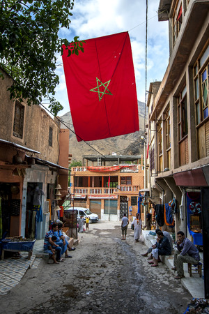 metres: A Moroccan flag flying in a street in the mountain village of Imlil. Imlil is a village in the high Atlas Mountains of Morocco. It is 1,740 metres (5,710 ft) above sea level.