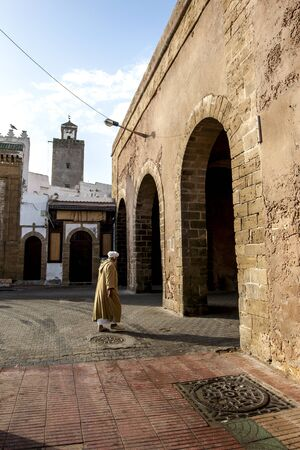 18th: A man walking towards on of the old city gates in Essaouira in Morocco. The present city of Essaouira was built during the 18th century by Mohammed III who wished to reorient his kingdom toward the Atlantic for security reasons. Editorial