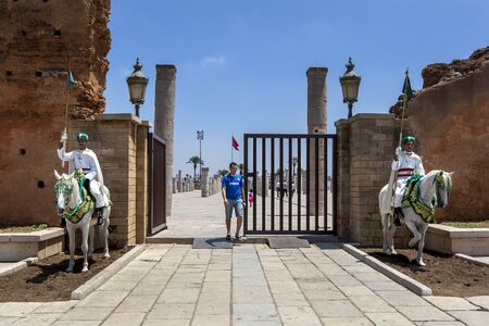 mounted: Mounted soldiers at the 12th Century walled entrance to Hassan Tower in Rabat, Morocco. Editorial
