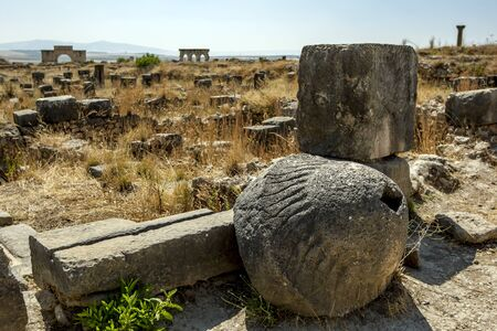 striated: A Roman stone oil press with a striated conical trunk at the ruins of Volubilis in Morocco. Stock Photo