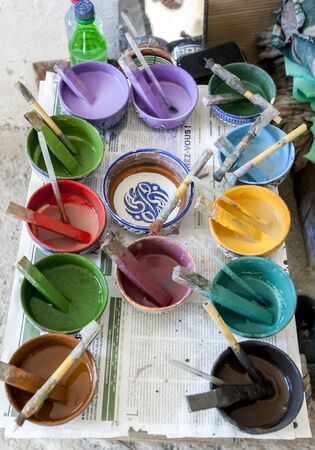 fez: A colourful variety of paint colours at the Art Naji factory in Fez, Morocco. The paints are used to hand paint ceramic ornaments in the factory