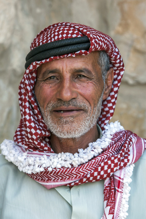 bedouin: A portrait of a Bedouin man wearing traditional headware in Jordan. Editorial