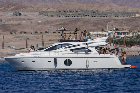 snorkelling: With a harsh desert backdrop, visitors to Aqaba aboard a luxury boat cool off in the waters of the Gulf of Aqaba. Known to have excellent diving and snorkelling reefs, Aqaba attracts visitors from across Jordan as well as many from Saudi Arabia during the Editorial