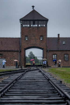 the nazis: A view showing the watch tower at the entrance to the Auschwitz-Birkenau Concentration Camp in Poland. Millions of prisoners were transported to the camp via this railway, with a vast majority meeting their death here at the hands of the Nazis. Auschwitz- Editorial