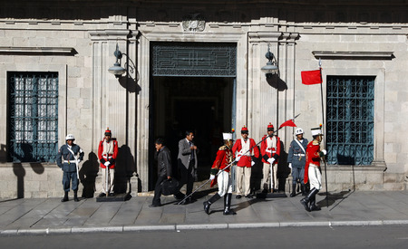 murillo: Changing of the guards outside the Palacio Quemado which is a popular name to denote the Bolivian Palace of Government. The building is located on Plaza Murillo in downtown La Paz. It is the official residence of the President of Bolivia. Editorial
