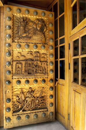 christian crosses: A beautifully carved wooden door on the Basilica of Our Lady of Copacabana, the famous Catholic church in Copacabana in Bolivia. Our Lady of Copacabana is the patron saint of Bolivia. Copacabana sits on the shore of Lake Titicaca. Editorial