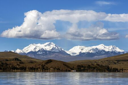 andes mountain: A view from Lake Titicaca towards the beautiful Andes mountain range and shoreline in Bolivia.
