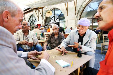 cay: Kurdish men play a game of dominos in the cay(tea) garden inside the Urfa Bazaar in Urfa (Sanliurfa) in eastern Turkey.