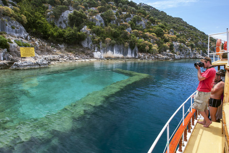 sunken boat: A tourist boat sales past a section of the Sunken City off Kekova Island in the western Mediterranean region of Turkey. Originally part of the ancient city of Simena, the island was hit by severe earthquakes in the 2nd century AD resulting in the island s