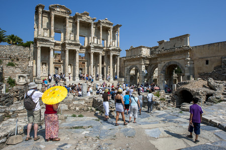 governor: Visitors to Ephesus near Selcuk in Turkey crowd around the ruins of the Library of Celcus. It was built by Consul Tiberius Julius Aquila in 114 AD in memory of his father Celcus Polemaeanus, a Roman governor of the region in the 2nd century AD. It held so