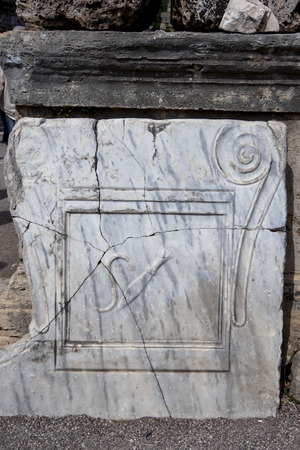 stone tablet: An knife inscription on a marble stone tablet which in ancient times wouold have signalled that the business adjoining was a butcher shop. It is part of the ruins of Perge in Turkey. Stock Photo