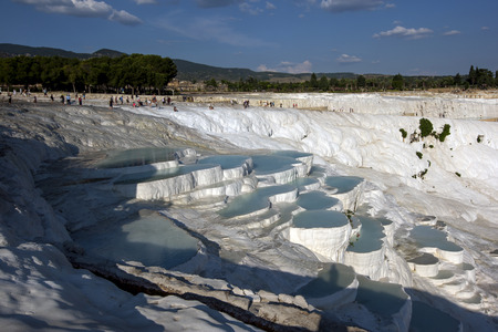 calcium carbonate: The late afternoon sun shines over the most spectacular section of natural thermal pools at Cotton Castle at Pamukkale in Turkey. The pools, also known as travertines, were formed over thousands of years after calcium carbonate rich spring water flowed ov