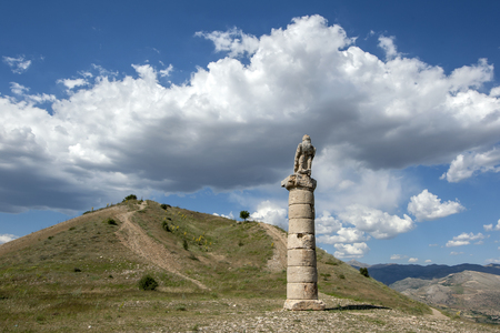 tumulus: An eagle sits atop a Roman column at the ancient site of Karakus Tumulus near the modern town of Salkimbagi in south eastern Turkey. Stock Photo